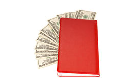 Hundred dollar bills money pile in a red notebook Royalty Free Stock Image