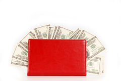 Hundred dollar bills money pile in a red notebook Stock Photo