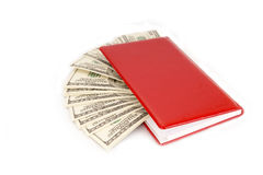 Hundred dollar bills money pile in a red notebook Stock Image