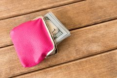 Hundred dollar bills in my wallet on a wooden table . On wooden royalty free stock photo