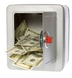Hundred Dollar Bills in open Safe. US Currency One Hundred Dollar Bills flowing out of an unlocked, open, metal  safe with a dial lock, isolated on white Royalty Free Stock Photography