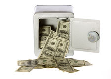 Hundred Dollar Bills in open Safe. US Currency One Hundred Dollar Bills flowing out of an unlocked, open, metal  safe with a dial lock, isolated on white Stock Photos