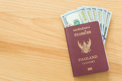 Hundred dollar bills passport Stock Photos
