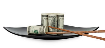 Hundred dollar bills on a plate. In the form of sushi with chopsticks Chinese Royalty Free Stock Photos