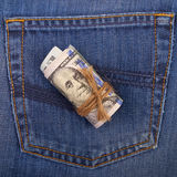 Hundred-dollar bills rolled and tied with a rope on the backgrou Royalty Free Stock Image