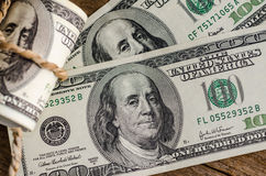 Hundred dollar bills rolled up Royalty Free Stock Image