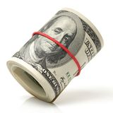 Hundred dollar bills rolled up with rubberband. On a white background Stock Photos