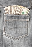 A hundred dollar bills sticking in the back pocket of denim Stock Photos
