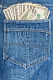 A hundred dollar bills sticking in the back pocket Stock Photos