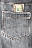 A hundred dollar bills sticking in the back pocket  jeans Stock Photo