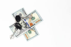 Hundred-dollar bills under the keys Royalty Free Stock Photos