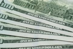 Hundred dollar bills fanned out royalty free stock image