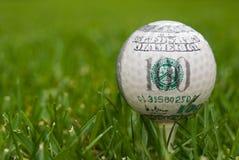 Hundred dollar golf ball Stock Photos