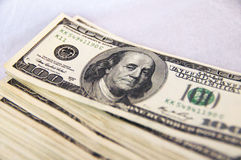Hundred-dollar notes. Pack of hundred-dollar notes on a table Royalty Free Stock Photography