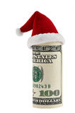 A hundred dollar roll in Christmas Santa hat Stock Photos