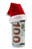 A hundred dollar roll in Christmas Santa hat Royalty Free Stock Photography