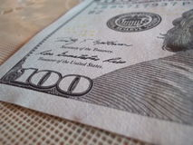 A hundred dollar. In a table focus and shot Stock Images