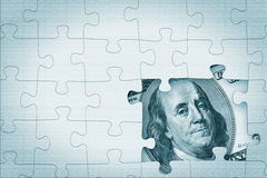 Hundred dollar under puzzle Stock Image