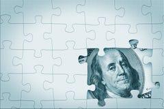 Hundred dollar under puzzle Stock Image