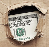 Hundred dollard in hole Stock Images