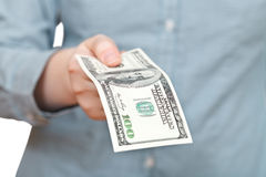 Hundred dollars banknote in arm Stock Photography