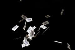 Hundred dollars banknotes fly on black background. money rain concept Stock Photo