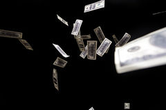 Hundred dollars banknotes fly on black background. money rain concept Royalty Free Stock Photos
