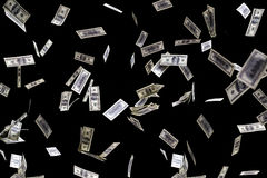 Hundred dollars banknotes fly on black background. money rain concept Stock Images