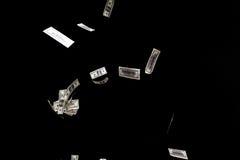 Hundred dollars banknotes fly on black background. money rain concept. One hundred dollars banknotes isolated fly on black background. money rain concept Royalty Free Stock Image
