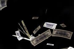 Hundred dollars banknotes fly on black background. money rain concept. One hundred dollars banknotes isolated fly on black background. money rain concept Stock Photo