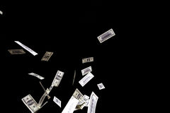 Hundred dollars banknotes fly on black background. money rain concept. One hundred dollars banknotes isolated fly on black background. money rain concept Royalty Free Stock Photos