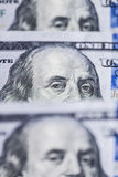 Hundred dollars bills standing in a row. Selective focus Royalty Free Stock Photos