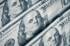 Hundred dollars bills standing in a row. Selective focus Stock Photos