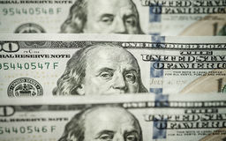 Hundred dollars bills standing in a row. Selective focus Stock Photography
