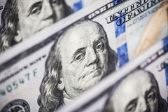 Hundred dollars bills standing in a row. Selective focus Stock Image