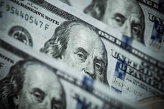 Hundred dollars bills standing in a row. Selective focus Stock Photo
