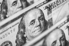 Hundred dollars bills standing in a row. Selective focus Royalty Free Stock Photo