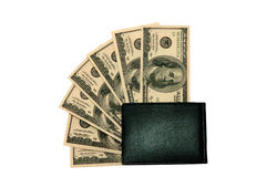 Hundred dollars bills in a wallet. Photo of hundred dollars bills in a wallet isolated over white background Royalty Free Stock Image