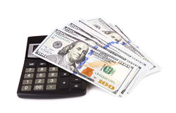 Hundred dollars. With a calculator  on white background Royalty Free Stock Photography