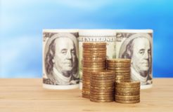 A hundred dollars with coins. Business concept Royalty Free Stock Photos