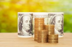 A hundred dollars with coins. Business concept Royalty Free Stock Image