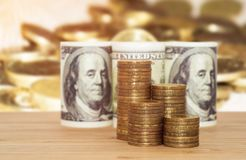 A hundred dollars with coins. Business concept Stock Photography