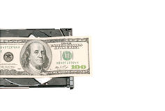 Hundred dollars are on the computer's cd-rom Stock Image