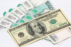 Hundred dollars and five thousand rouble banknotes Stock Photos