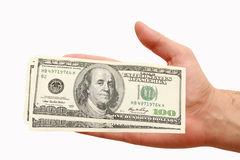 Hundred dollars in hand. On white background Stock Photography