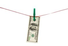 Hundred Dollars hang on clothes peg Stock Photography