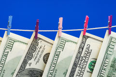 Hundred dollars hanging on a clothesline Stock Images
