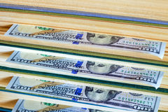 Hundred dollars lie between pages. Royalty Free Stock Image