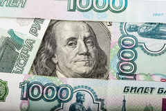 Hundred dollars and Russian banknotes Stock Photos