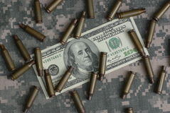 Hundred dollars and shell. On combat uniform Stock Photography